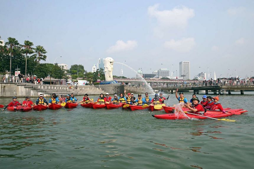 Participants taking a kayaking heritage trail through the Marina Bay area, after the launch of the new community club yesterday. It is the first to offer both CC staples as well as water-based activities.