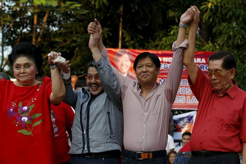 Philippine Senator Ferdinand Marcos Jr (third from left) being endorsed as a vice-presidential candidate in next May's national elections by (from left) his mother and former first lady Imelda Marcos, former president Joseph Estrada and Senator Juan
