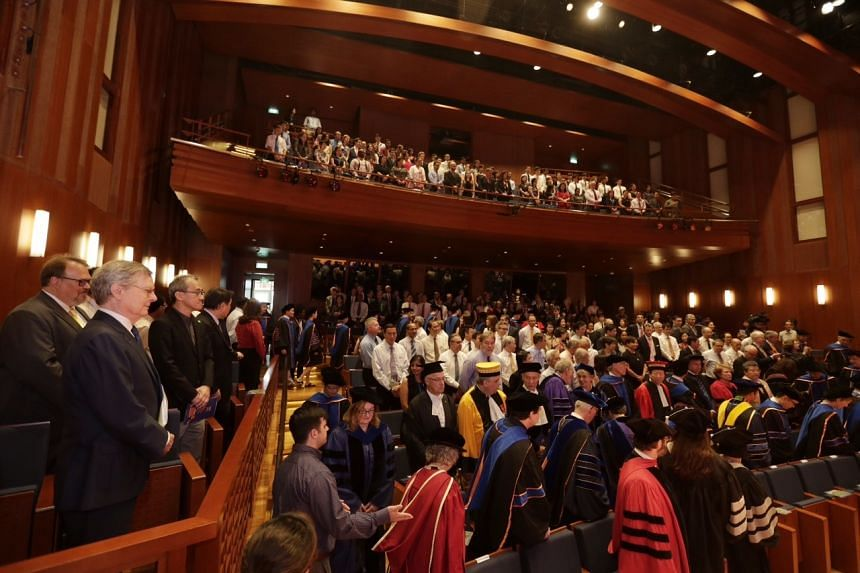 Yale-NUS senior management and faculty enters the auditorium in a ceremonial procession during the inauguration of the college.