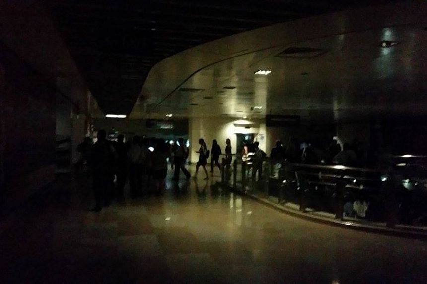 Morning commuters spotted in the dark at Serangoon NEL gantry.