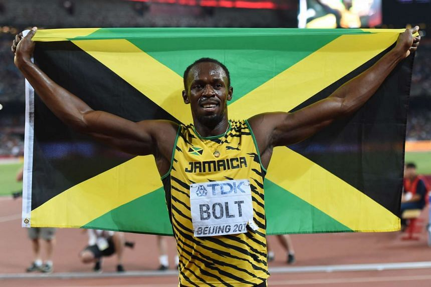 """Jamaica's Usain Bolt celebrates after winning the men's 200m event at the 2015 IAAF World Championships at the """"Bird's Nest"""" National Stadium in Beijing on Aug 27, 2015."""