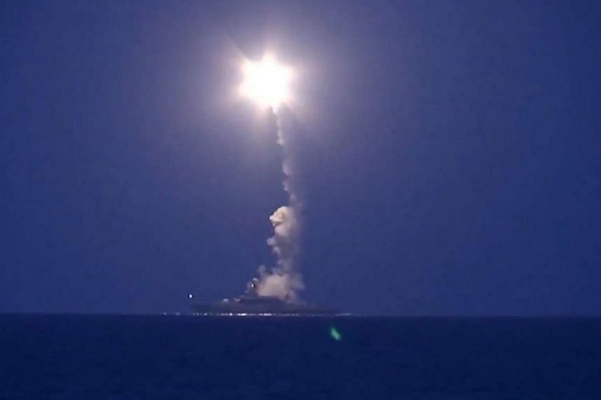 A warship of the Caspian Flotilla launching missiles from the deployment area in the south-western Caspian Sea in an image taken from a video on Oct 7, 2015.