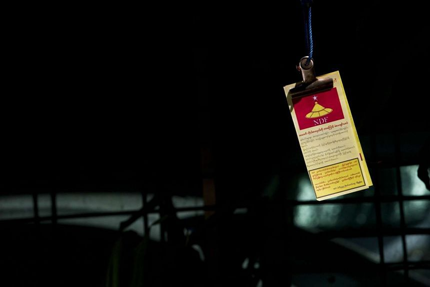 Flyers for the National Democratic Force (NDF) party hang from a string, left by party members campaigning for the general election on Nov 8, 2015.
