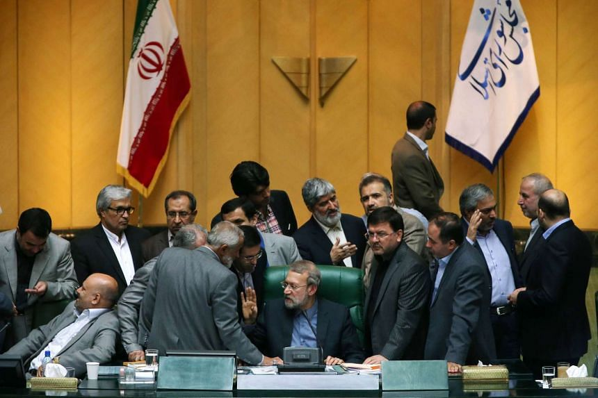Iran's Parliament approved a historic nuclear deal with world powers on Oct 13, 2015, which will lift nuclear-related sanctions on Iran in return for curbs on its atomic activities.