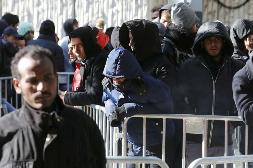 Migrants queue in the compound outside the Berlin Office of Health and Social Affairs (LAGESO) as they wait to register in Berlin, Germany.