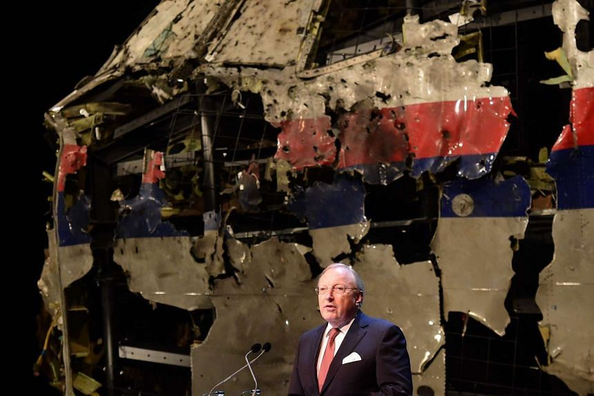 Dutch Safety Board Chairman Tjibbe Joustra speaks in front of the wrecked cockpit of Malaysia Airlines flight MH17 during a presentation of the final report on the cause of the its crash at the Gilze Rijen airbase, on Oct 13, 2015.