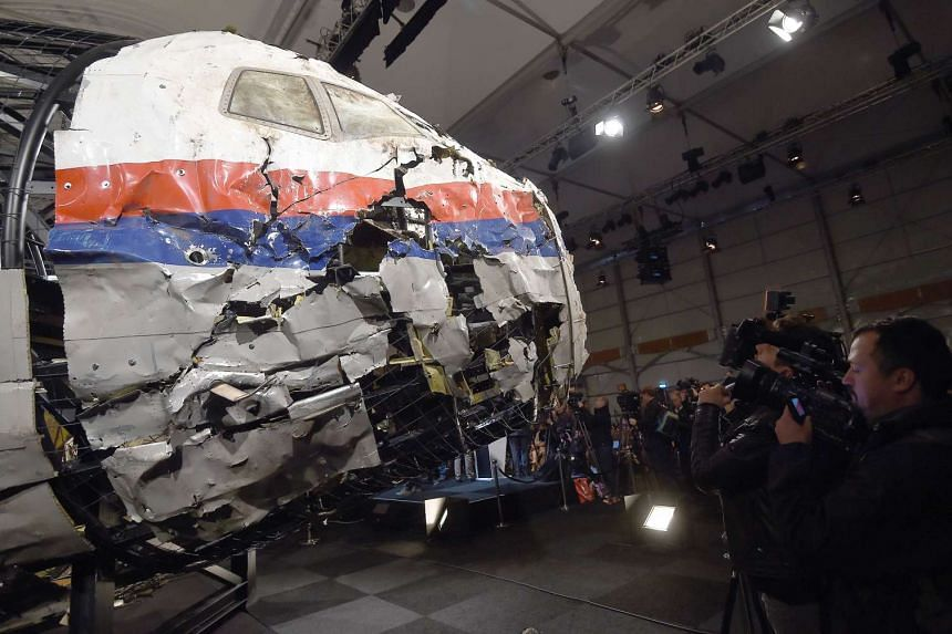 The wrecked cockipt of Malaysia Airlines flight MH17 is presented to the media at Gilze Rijen airbase on Oct 13, 2015.