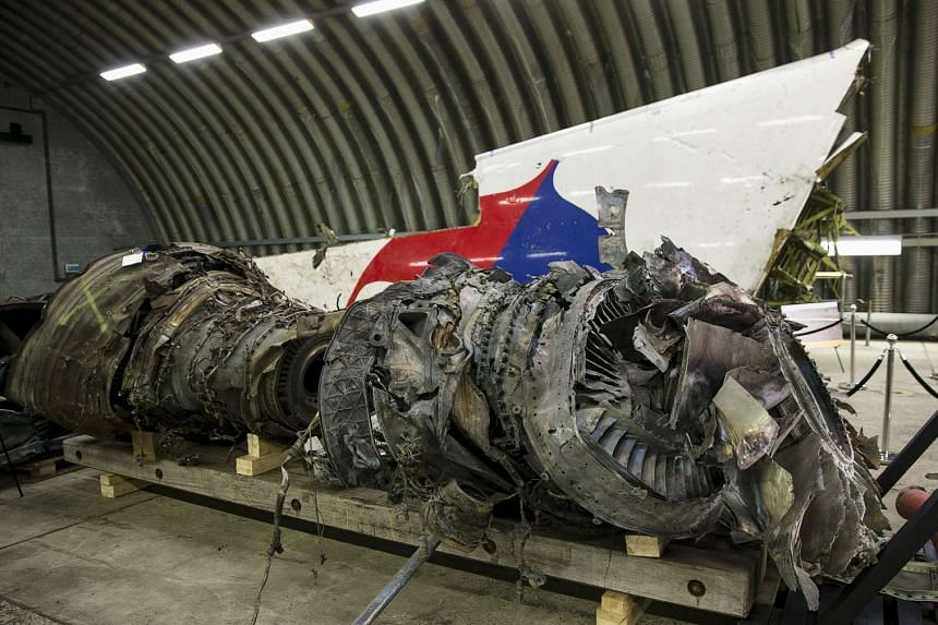 A wrecked engine from Malaysia Airlines flight MH17 is seen at a presentation by the Dutch Safety Board at Gilze Rijen airbase on Oct 13, 2015.