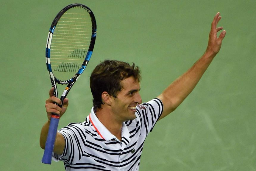 Albert Ramos-Vinolas of Spain celebrating after winning his men's singles second round match against Roger Federer of Switzerland at the Shanghai Masters tennis tournament in Shanghai on Oct 13, 2015.