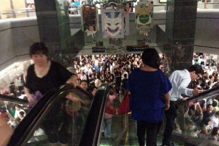 The crowded scene at Dhoby Ghaut North-South Line MRT platform.