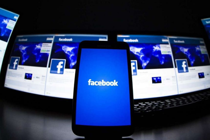 The loading screen of the Facebook application on a mobile phone is seen in this photo illustration taken in Lavigny on May 16, 2012. Facebook said on Monday (Oct 12) that it will begin testing a shopping tab for its mobile app as it works to ramp up