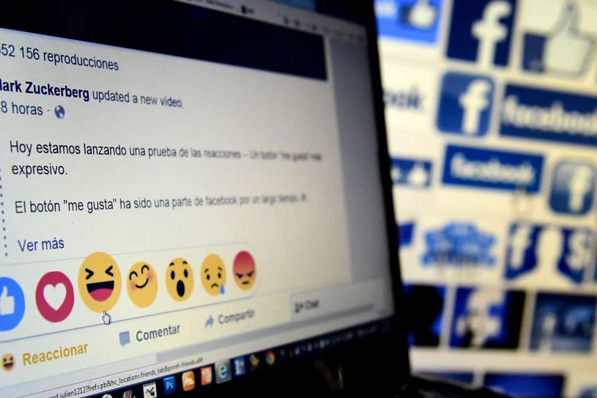 "A picture taken on Oct 9, 2015 in Madrid shows a computer screen displaying the Facebook webpage with the new ""Reactions"" options as an extension of the ""like"" button, to give people more ways to easily signal how they feel. Facebook will begin testi"