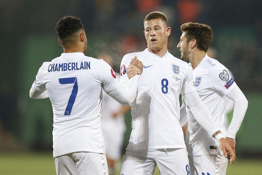 Ross Bakley (centre) celebrates with Alex Oxlade-Chamberlain (left) after scoring the first goal for England.