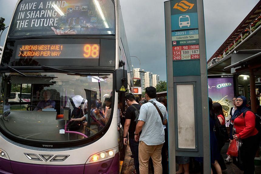 Evening commuters boarding a bus at Lakeside MRT station on Apr 22, 2015.