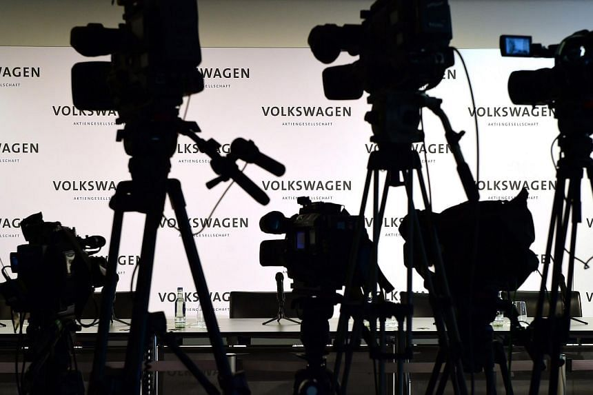 Empty chairs and cameras are pictured prior to a press conference to announce the new Volkswagen CEO amid a pollution scandal at the German carmaker's headquarters in Wolfsburg on Sept 25.