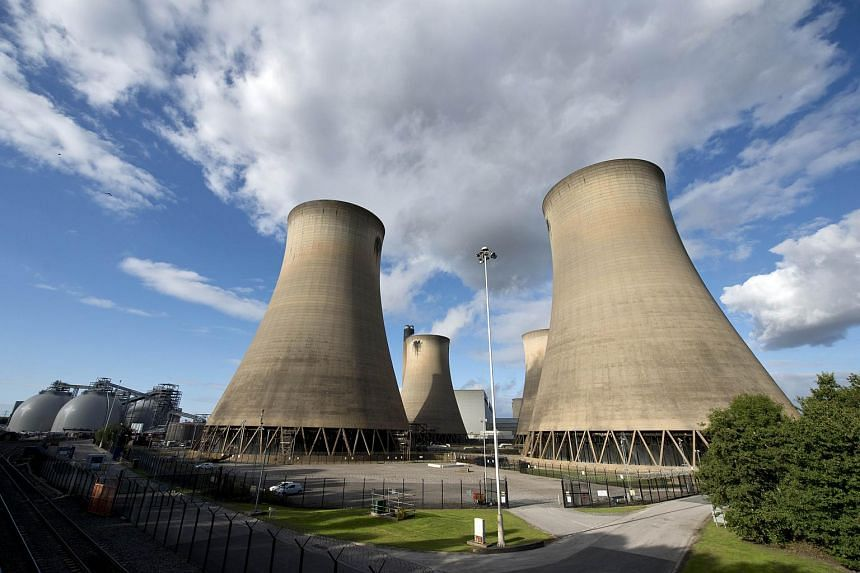 A view of the cooling towers of a coal-fired power station in England on Sept 25, 2015.