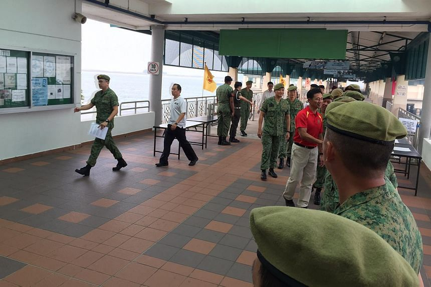Senior Minister of State for Defence Ong Ye Kung at the Basic Military Training Centre at Pulau Tekong on Tuesday morning. This is his  first visit to an SAF camp since he was sworn into office on Oct 1.