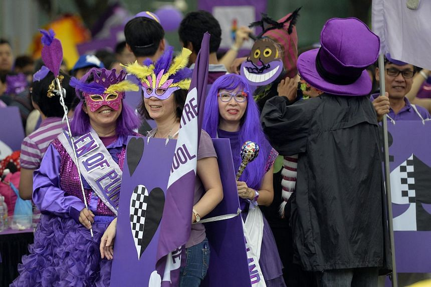Participants all dressed up at the Purple Parade event in Hong Lim Park.