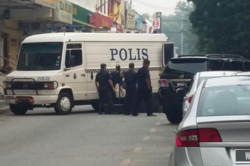 The police bomb squad at the scene in Ayer Keroh, Malacca.