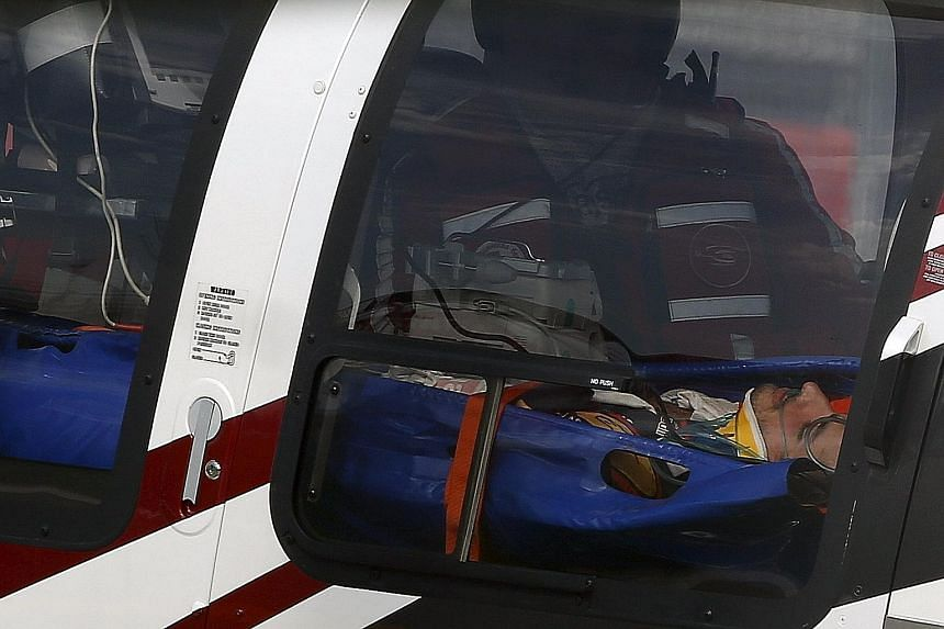 Carlos Sainz in a medical helicopter after crashing during practice. He recovered to race on Sunday.