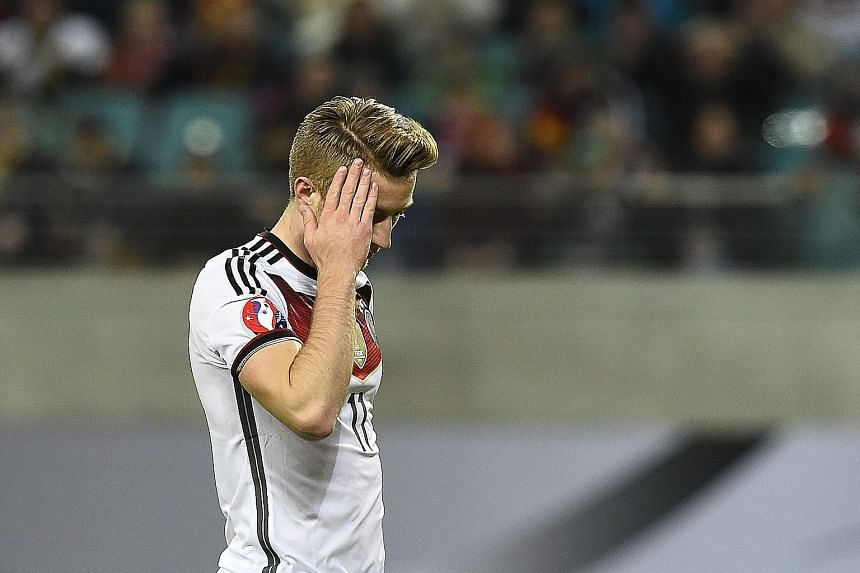 Marco Reus ruing yet another miss against Georgia. Though Germany won their group, they have not adapted to changes.