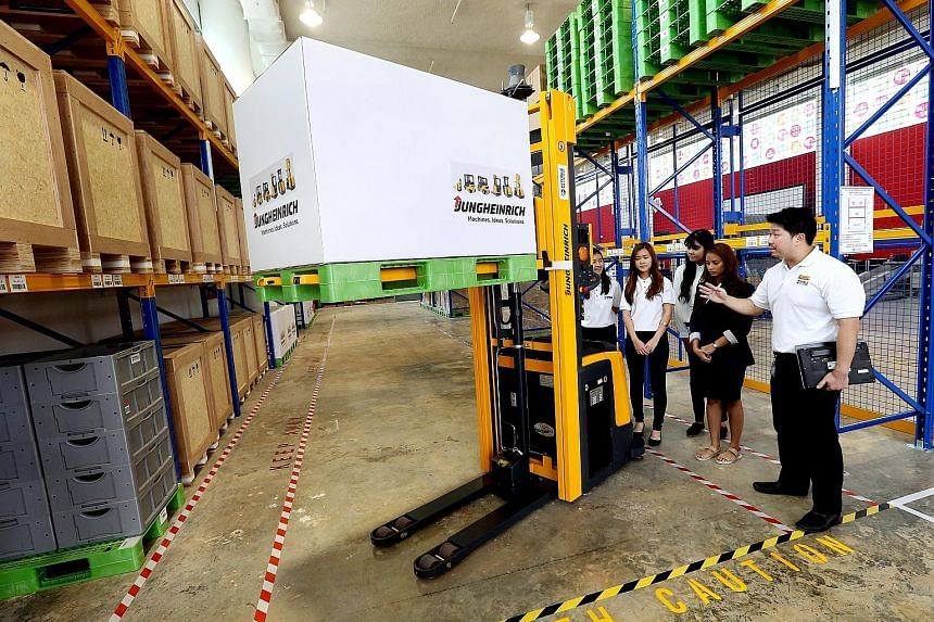 Students on the new Earn and Learn Programme for the logistics industry learning about the driverless forklift at the Supply Chain Innovation Lab which was unveiled yesterday at Republic Polytechnic.