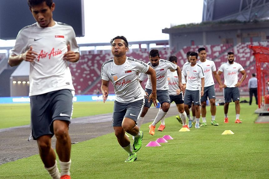 The Lions training at the National Stadium yesterday for tonight's World Cup qualifier against Cambodia.
