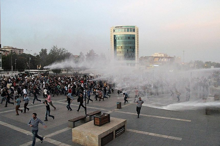 Turkish police trying to disperse demonstrators who were marching in Diyarbakir on Sunday to protest against the suicide bombings.