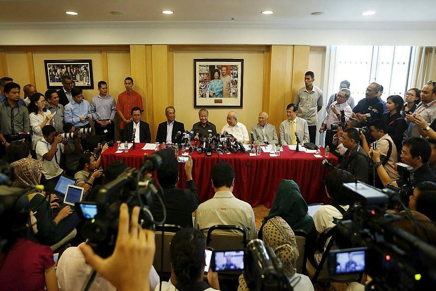 (Seated, from left) Umno vice-president Shafie Apdal, Umno deputy president Muhyiddin Yassin, former premier Mahathir Mohamad, MP Tengku Razaleigh Hamzah, former Umno secretary-general Sanusi Junid, and former MCA president Ong Tee Keat at a press co