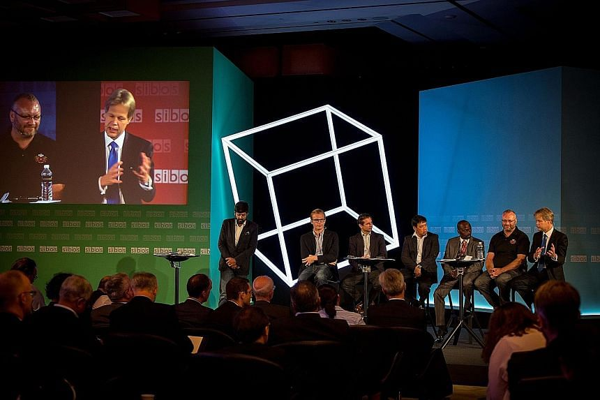 Exchanging views at a Sibos conference yesterday were (from far left) Apis Partners co-founder Udayan Goyal, Kreditech co-founder Alexander Graubner- Mueller, Iwoca chief executive Christoph Rieche, Cignifi Asia managing director Jojo Malolos, Mode c