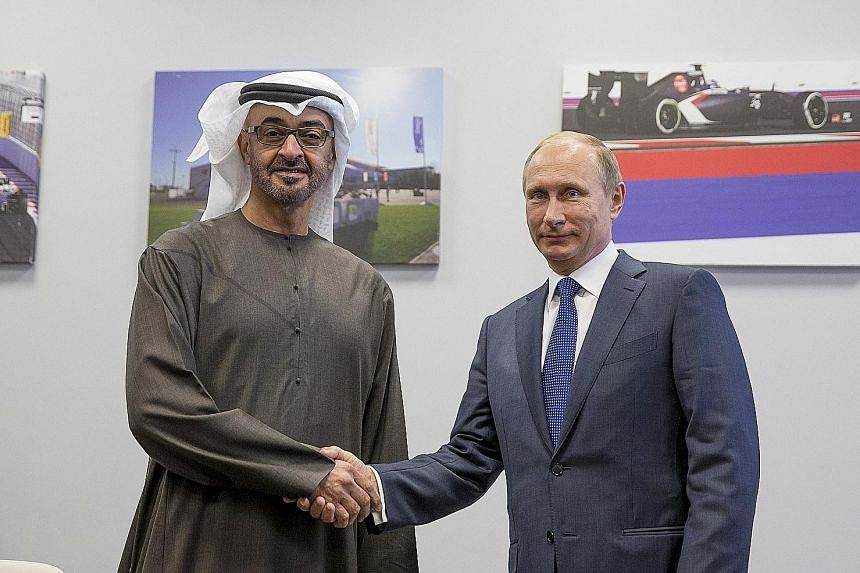 Mr Putin with Abu Dhabi's Crown Prince Sheikh Mohammed Zayed Al Nahyan in Sochi on Sunday.