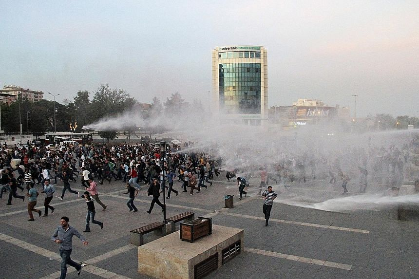 Police in Diyarbakir, Turkey, using tear gas and water cannon on Sunday to disperse protesters rallying against the double suicide bombing in Ankara that killed 97 people, according to official estimates. The deadliest attack in Turkey's recent histo