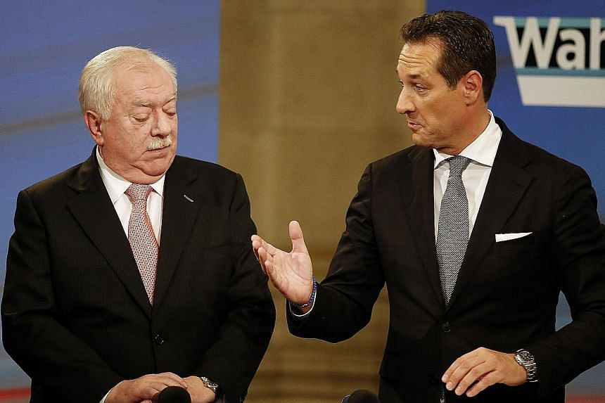 Vienna's long-time mayor, Mr Michael Haupl (left), and his challenger, Mr Heinz-Christian Strache of the Freedom Party, talking after elections in Vienna on Sunday.