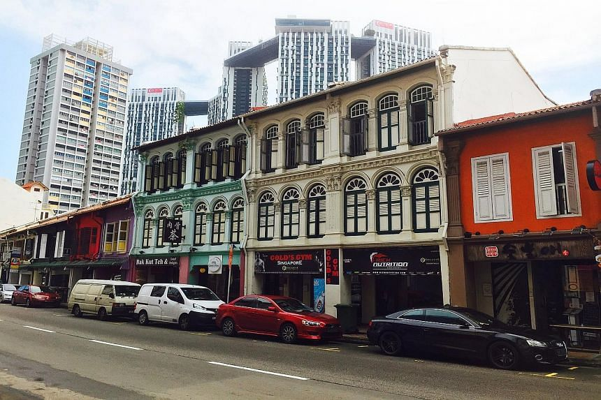 The pair of adjoining conservation shophouses at 84 and 86 Tanjong Pagar Road (above) has 71 years remaining on its tenure, and the indicative pricing for the property is $9.5 million.