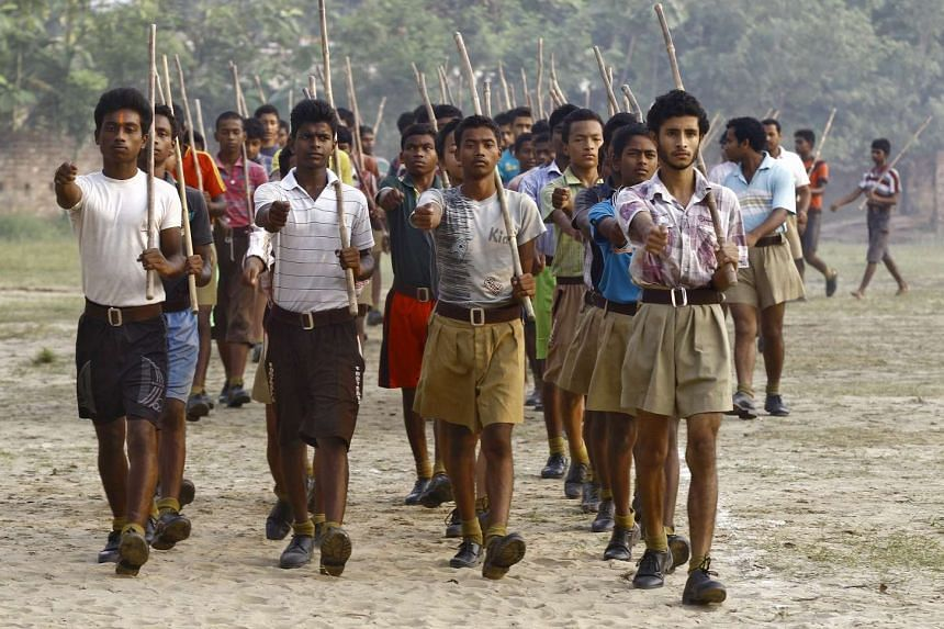 Volunteers of the Hindu nationalist organisation Rashtriya Swayamsevak Sangh hold sticks as they march during a training session in West Bengal, India, on May 20, 2015.