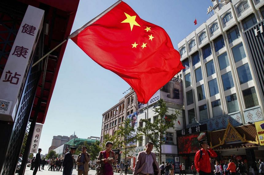 A China flag displayed on the main street of Wangfujing shopping and tourist district in Beijing, China.