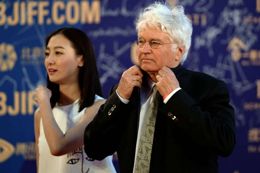 French director Jean-Jacques Annaud (right) arriving for a red carpet event during the opening ceremony of the fifth Beijing International Film Festival.