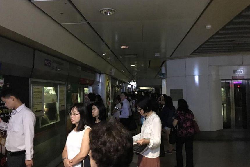 Commuters at Serangoon NEL train platform.