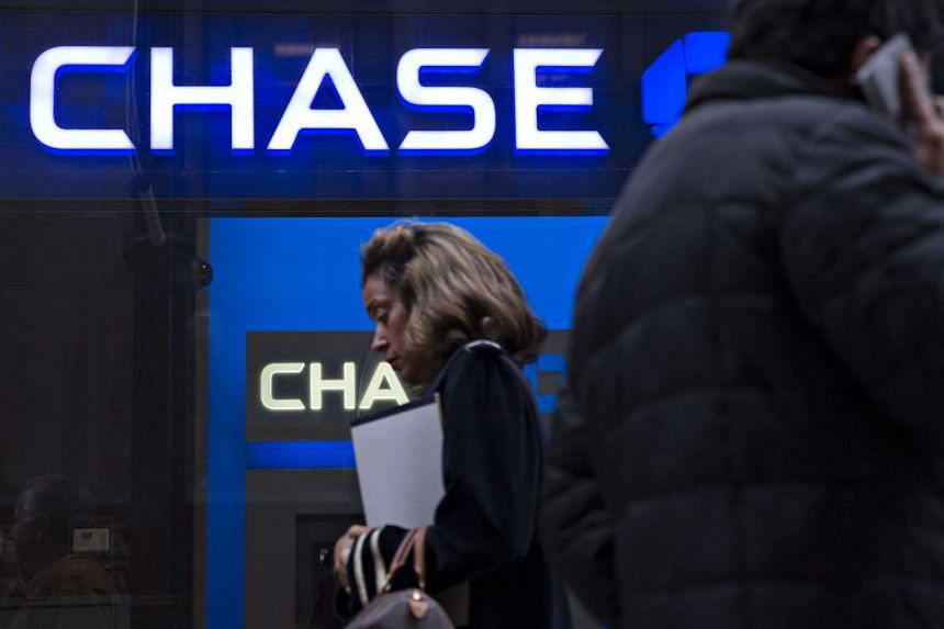 Pedestrians walking past a JPMorgan Chase & Co branch in Chicago on Oct 5.