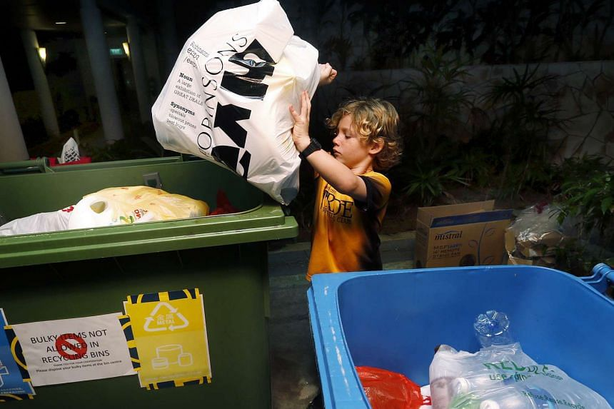 Six-year-old Bowen Beckman wakes up at 5am every Tuesday to collect recycling bags at his condominium block.