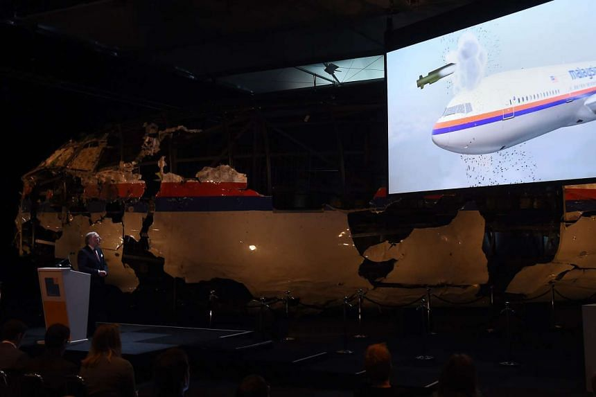 Dutch Safety Board Chairman Tjibbe Joustra speaking as a simulation showing the flight path of the missile plays on the screen, at Gilze Rijen airbase on Oct 13, 2015.