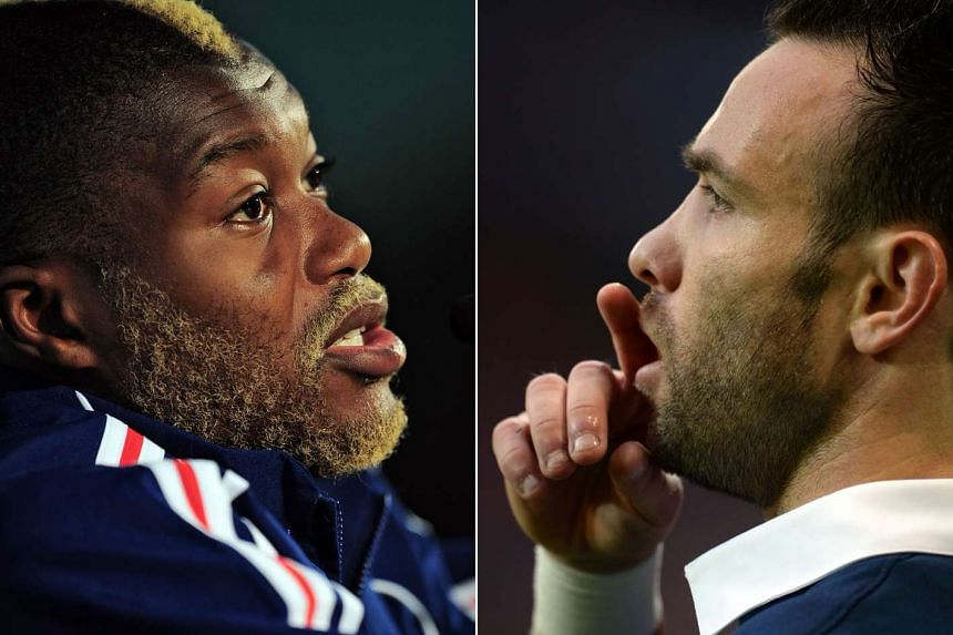 French football players Djibril Cisse (left) and Mathieu Valbuena. Cisse was one of four people arrested by French police on Oct 13, 2015.