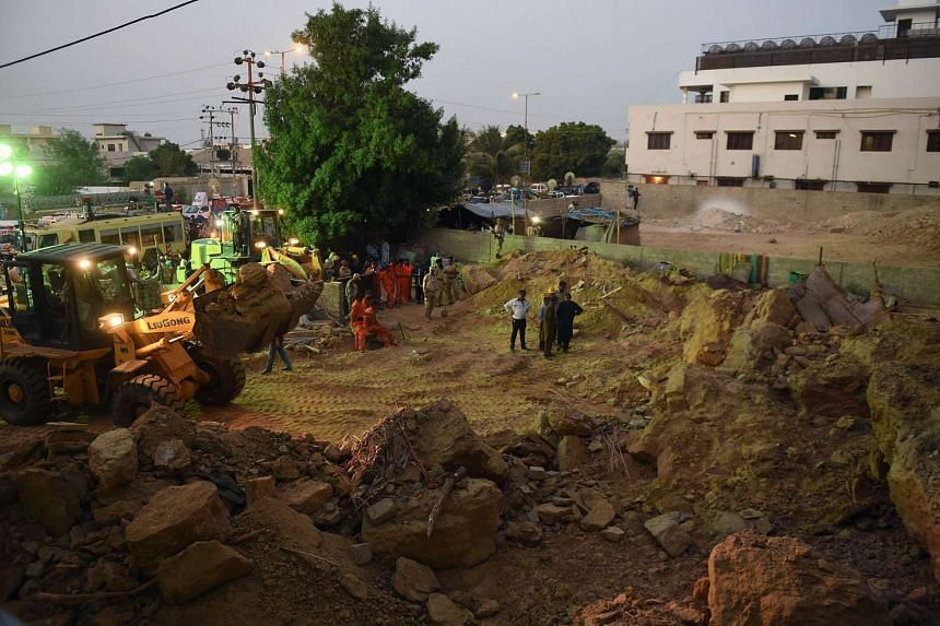 Thirteen people, including seven children, were crushed to death in Karachi, Pakistan on Tuesday.
