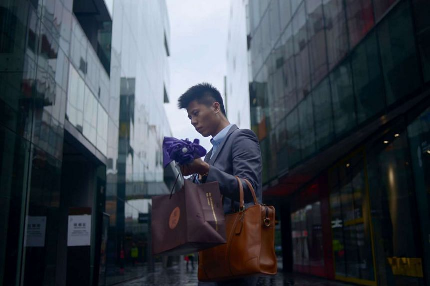 A man walks past a mall in Beijing on Sept 29, 2015.