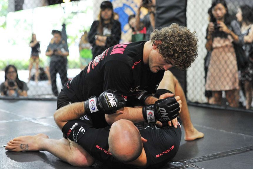 American Olympic wrestler Ben Askren (top) during his workout with head coach of Evolve MMA Heath Sims.
