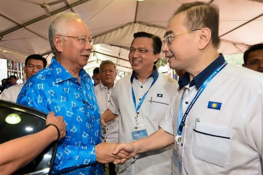 (From right) Malaysian Chinese Association's deputy president Wee Ka Siong and president Liow Tiong Lai welcoming Mr Najib at the annual general assembly.