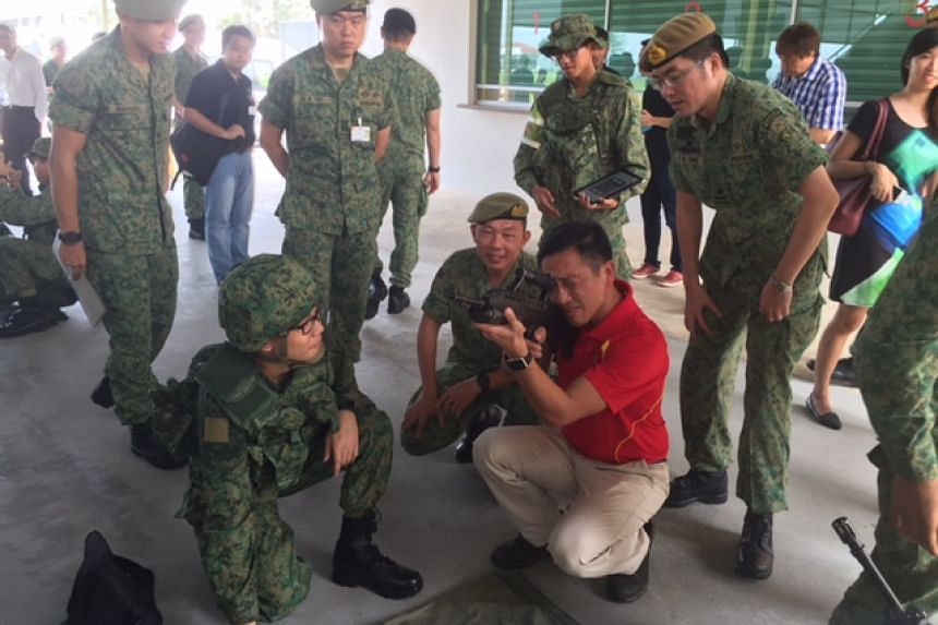 Senior Minister of State for Defence Ong Ye Kung attending a weapons handling session at the BMTC.