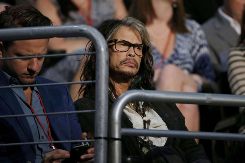 Musician Steven Tyler (centre) of the band Aerosmith listens from the audience during the first official Republican presidential candidates debate of the 2016 US presidential campaign in Cleveland, Ohio, on August 6.