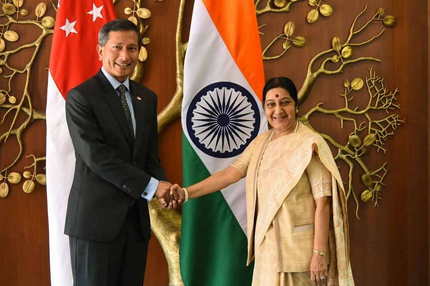 Dr Vivian Balakrishnan with India's External Affairs and Overseas Indian Affairs Minister Sushma Swaraj in New Delhi yesterday.