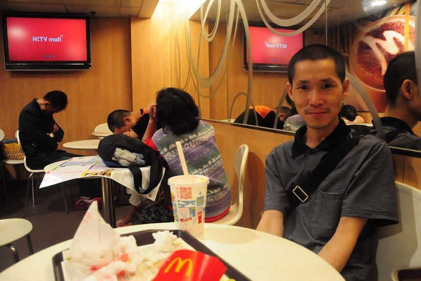 Mr Chung Chi Man, 42, is among the homeless in Hong Kong who have chosen to shelter at a McDonald's outlet when night comes. The odd-job worker says he has no choice, and knows he may well meet the same fate as an unknown woman who died at another